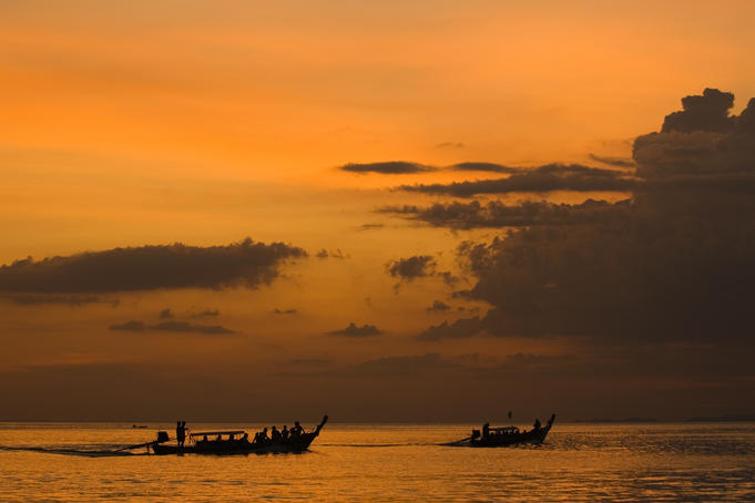 Boats off Rai Leh West Beach under a golden light.