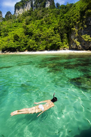 Woman snorkelling at Maya Bay.