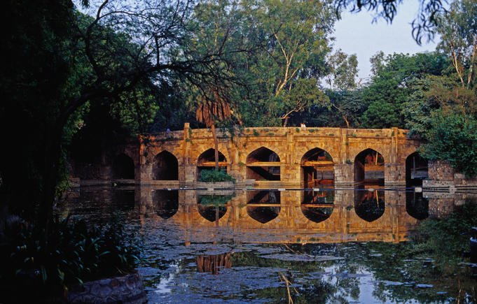 Eight tiered, 16th century stone bridge called Athpula in Lodi Gardens.