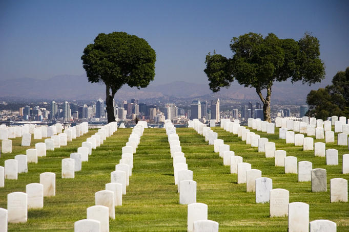 Row of headstones at Fort Rosecrans National Cemetery, Point Loma, looking towards downtown San Diego.
