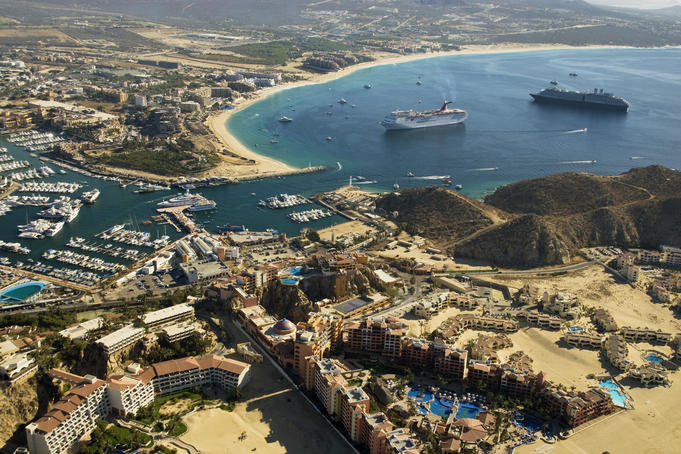 Aerial of Cabo San Lucas with cruiseships in bay.