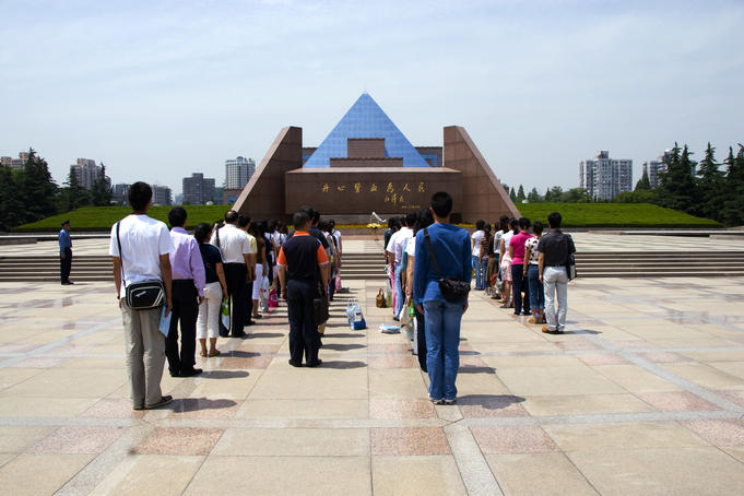 Visitors lining up at the Martyrs Memorial.