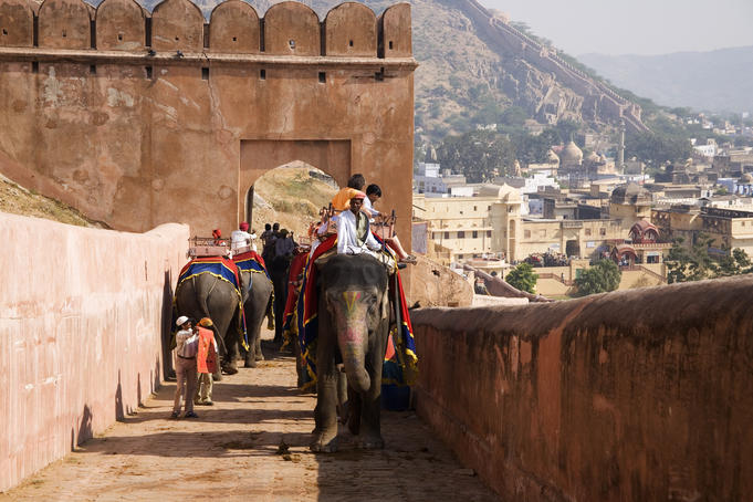 Tourists arrive by elephant at Amber Palace.