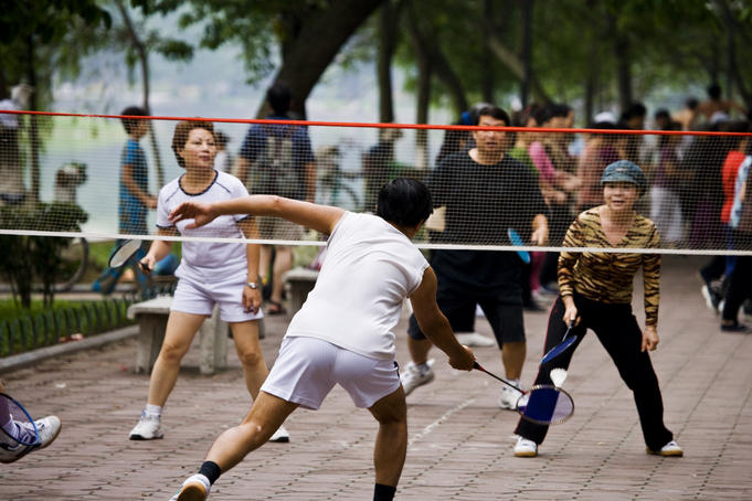 Playing badminton beside Hoan Kiem Lake.
