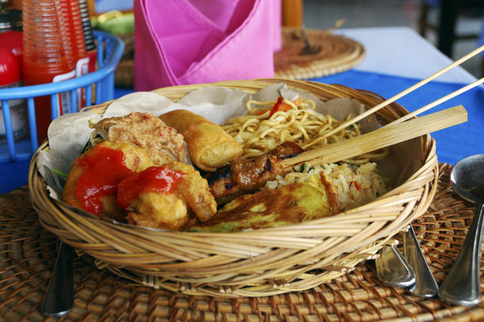 Fried food, noodles and rice served in a basket at Grand Puncak Sari Restaurant.
