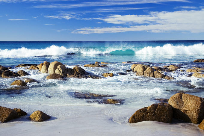 Wave breaking onto rocky shore at Friendly Beaches.