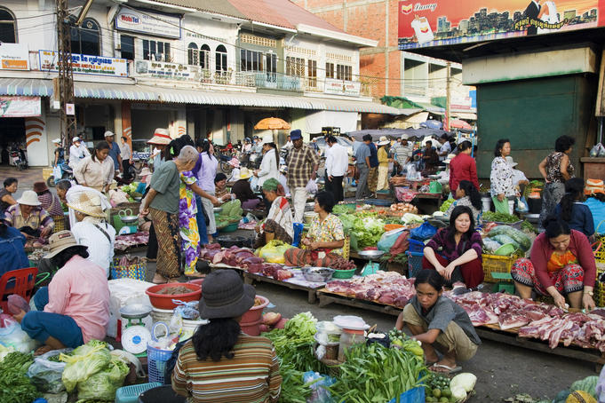 Shoppers and vendors with a variety of meat and produce at Psar Nat market.