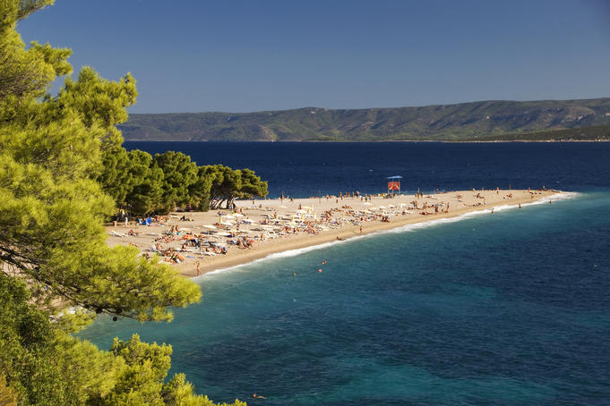 Zlatni Rat beach and sunbathers.