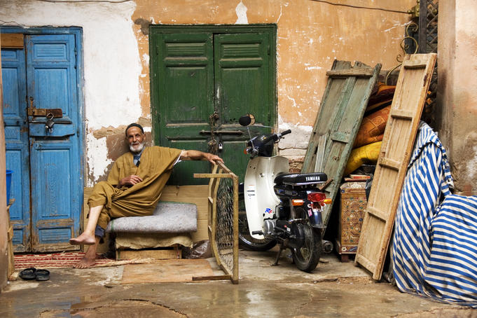 Moroccan man relaxing in the backstreets of Marrakesh.