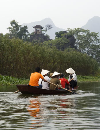 Passenger-laden row boat on the Yen River, en route to Perfume Pagoda (Chua Huong) complex.