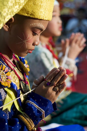 Boy praying at Wat Pa Pao temple during Poi Sang Long festival (for ordination of novice monks).