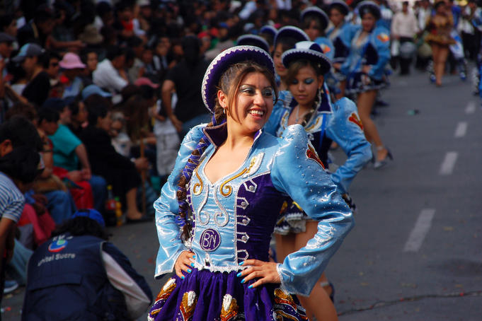 Costumed dancer celebrating Fiesta de la Virgen de Guadalupe.