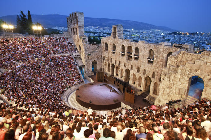 People inside the Odeon of Herodes Atticus waiting for theatrical perfomance to begin.