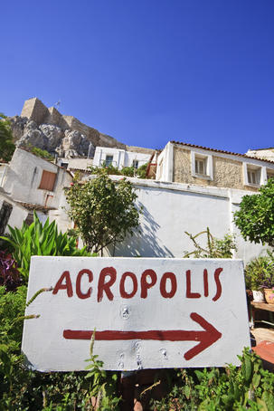 Sign in Anafiotika area showing the way to Acropolis.