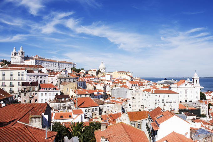 Rooftops across Alfama from the miradouro at Largo das Portas do Sol.