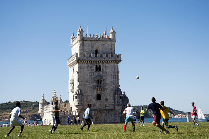 Football game between locals in park next to Torre de Bel
