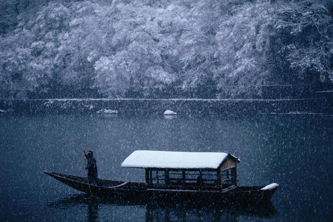 A traditional leisure boat during a snowfall at Arashiyama west of Kyoto.