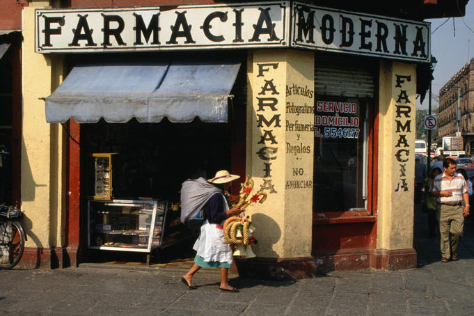 Pharmacy on a street corner at Plaza Hidalgo.