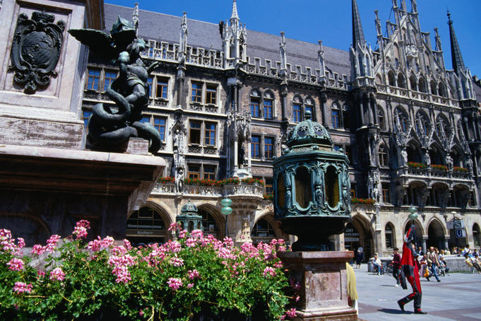 Statues, flowers and the New Town Hall, built in the neo-Gothic style