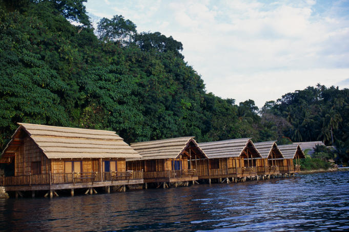 Timber Badjao houses built on the water in the style of the sea gypsies.