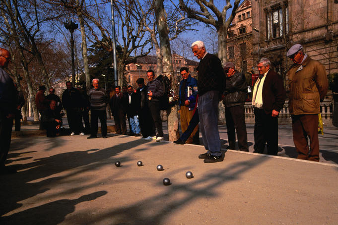 Men playing Boules in a square - Barcelona, Catalonia