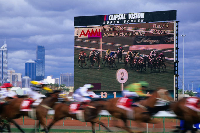 A big screen backdrops the 1999 Victoria Derby at Flemington.