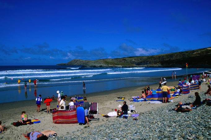 People crowd the beach on Whitesands Bay, Pembrokeshire Coast - Dyfed, Pembrokeshire, Wales