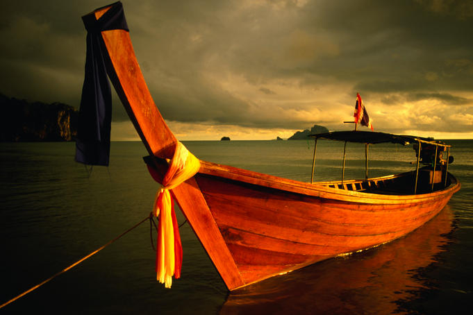 Longtail boat with ribbons.