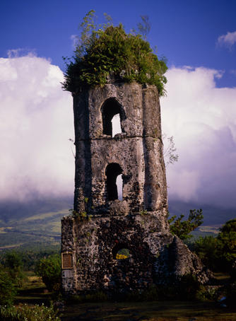 The ruined tower of the Cagsawa church still stands proudly, though a little overgrown, having endured the eruption of the Mount Mayon volcano.
