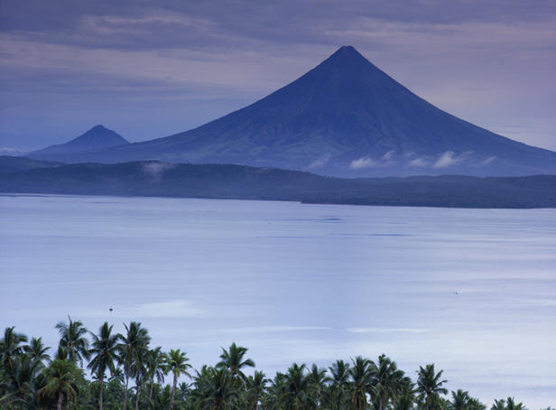 Mt Mayon, one of the world's most dangerous volcanoes, surrounded by other volcanoes.