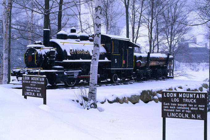 The Loon Mountain Railway: a parked train engine covered in snow