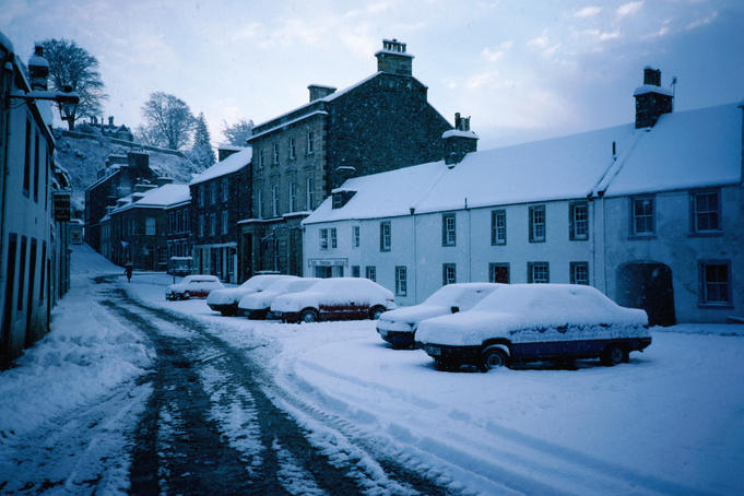 Cars under snow in the High Street of Dunkeld - Perth and Kinross, Scotland