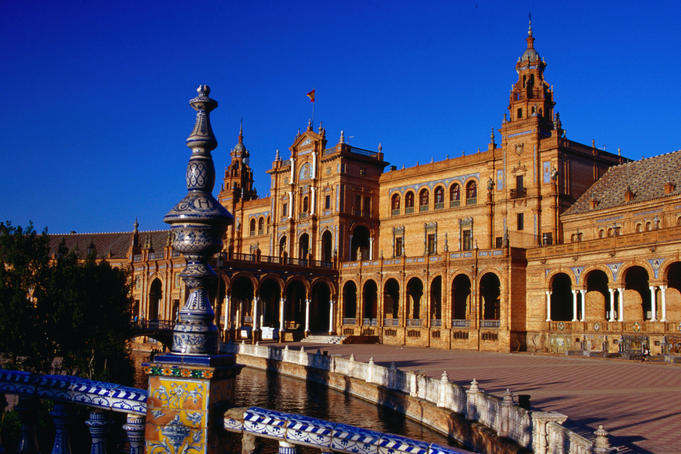 Exterior of favourite relaxation spot Plaza de Espana, has fountains, mini canals, row boats and traditional tile work.