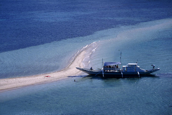 A narrow sand spit on Snick Island is a popular place to stop for a swim, El Nido