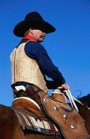 A cowboy riding a horse in the Tucson Rodeo Parade