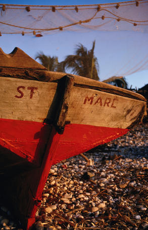 Fishing boat and net on the beach
