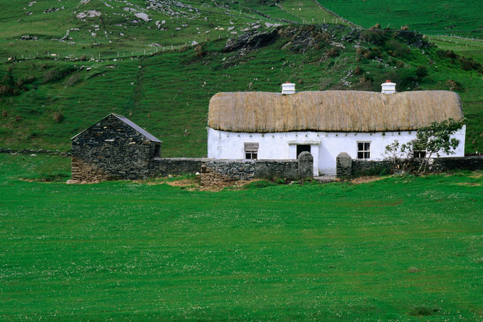 A traditional farmhouse with thatched roof in Glencolumbcille, County Donegal
