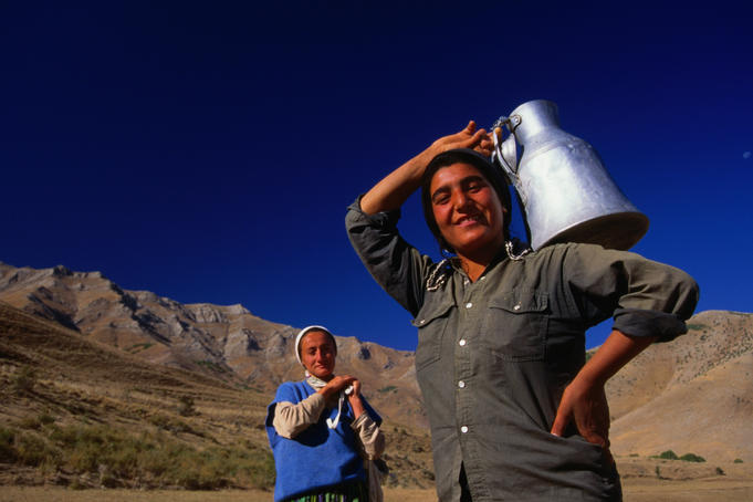 Happy village women carrying water, near Van