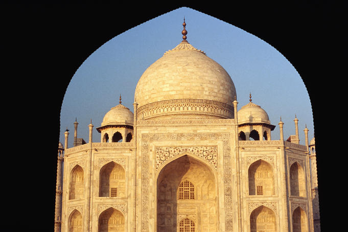 The Taj Mahal framed by an arch of the building built to provide symmetry with the mosque in the Taj Mahal grounds