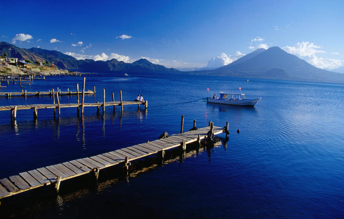 Lake Atitlan boat jetties with the view of Toliman and Atitlan Volcanoes