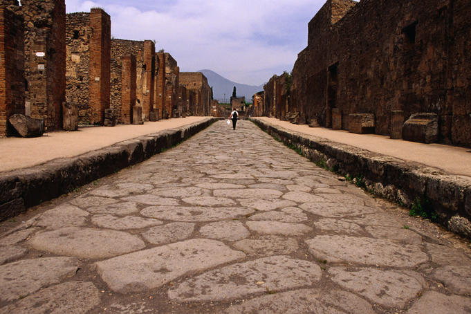 Looking along Vicolo di Mercurio in Pompeii which houses Casa dei Vettii, a collection of well-preserved paintings and statues. The town of Pompeii was covered in volcanic ash in 79AD when Vesuvio erupted.