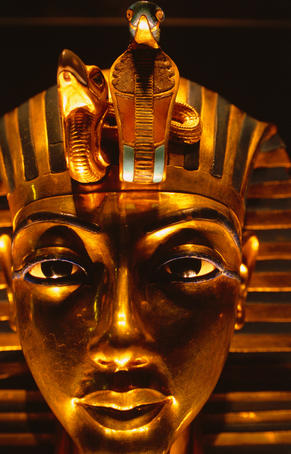 Tutankhamun's exquisite death mask. Made of beaten gold and inlaid with precious stones this most famous of archaeological treasures can be discovered at The Egyptian Museum.