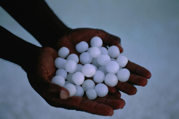 Spherical salt crystals, held in open hands