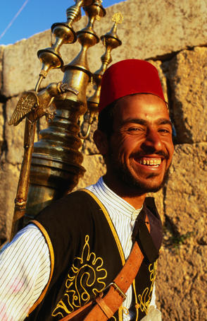 Portrait of smiling drinks vendor.