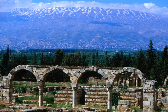 The significant Umayyad site of Aanjar: the mountain ranges behind archways and ruins