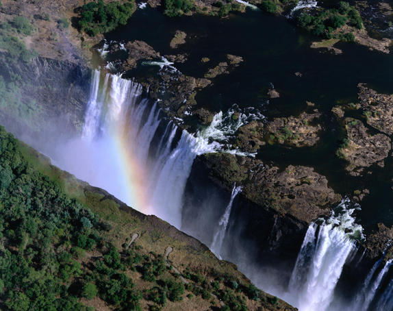 The world famous Victoria Falls, it has a 1.7 kilometre precipice and an average of 550,000 cubic metres of water plummeting 90 to 107 metres below into the Zambezi gorges every minute