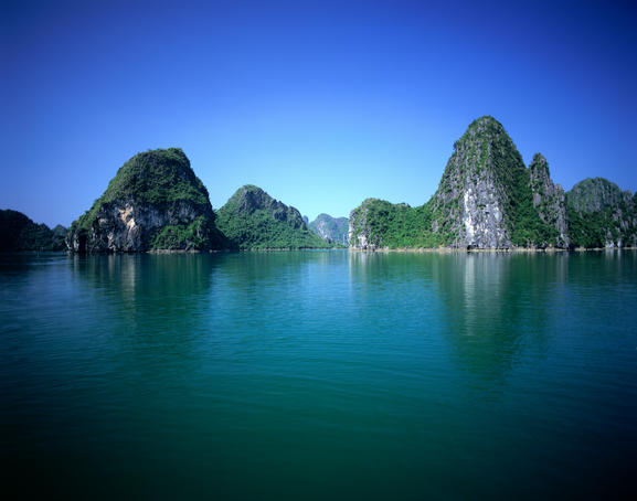Halong Bay in the Gulf of Tonkin. The magnificent bay with its 3000 islands and islets of carboniferous chalk is the natural marvel of Vietnam