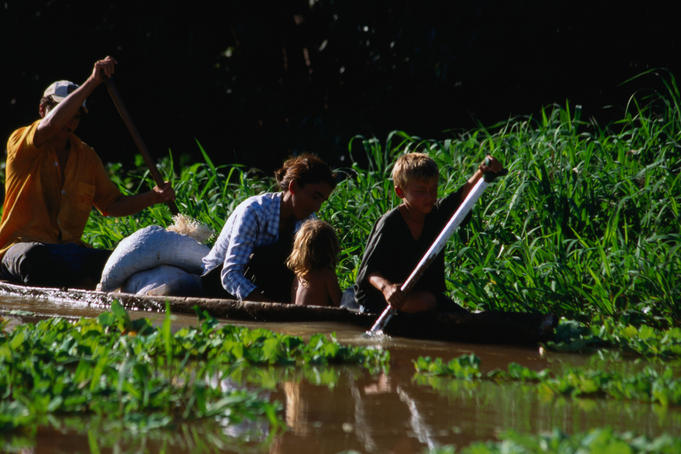 Locals paddling around the Parana Anavilhanas Archipelago, in the traditional dug out canoe- Amazonas, Brazil