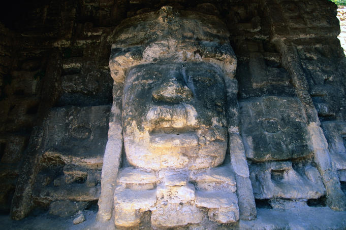 Detail of a stucco mask at Lamanai, structure N9-56, depicting a man in a crocodile-mouth headdress.