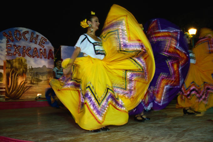 Dancers wearing a colourful costume performs at La Noche de Mexico festival.